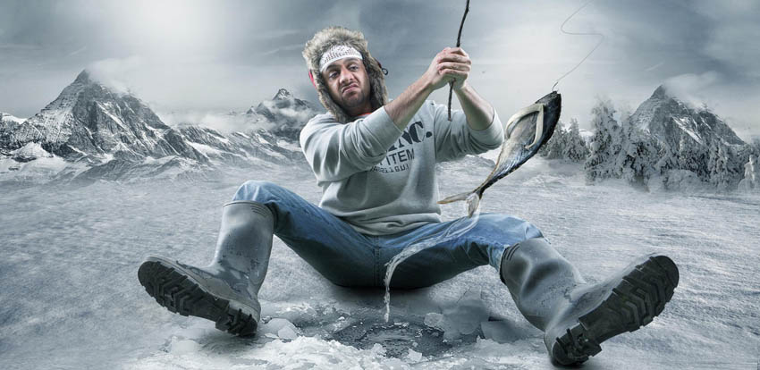 A man on the ice fishing